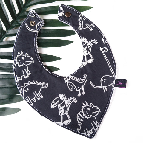 Navy blue dinosaur dribble bib for babies and toddlers