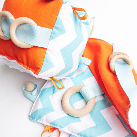 Blue and orange baby cube and sensory blanket toy set