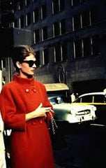 Old photo of Audrey Hepburn in a red vintage coat - SoLovesVintage
