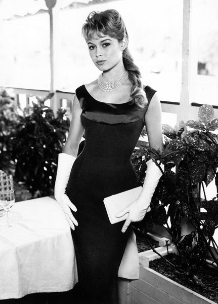 Brigitte Bardot in a black wiggle dress and white gloves
