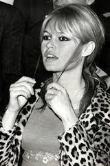 An old photo of Brigitte Bardot in a leopard coat - SoLovesVintage