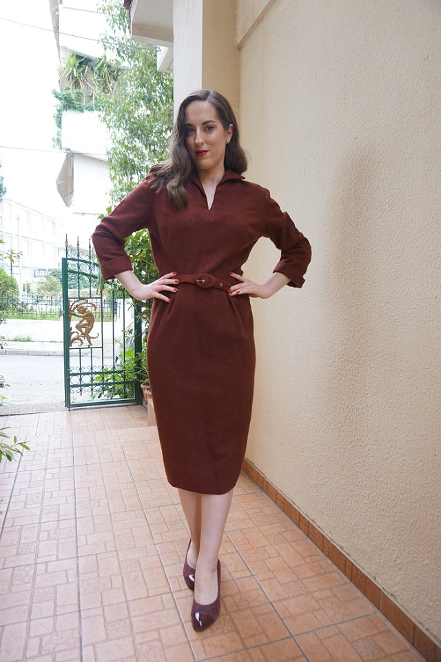 Fashion blogger Marianna Chalkiadaki is wearing a 50's burgundy dress by SoLovesVintage