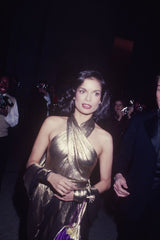 Bianca Jagger on her way to studio 54 in a gold dress