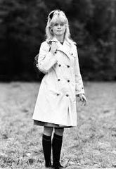 A vintage photo of Brigitte Bardot in a trench coat - SoLovesVintage