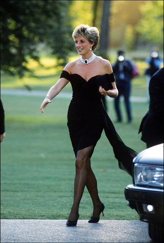 Diana Princess of Wales is wearing a black mini dress
