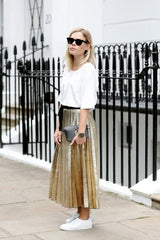 Wear a gold skirt with a white jumper