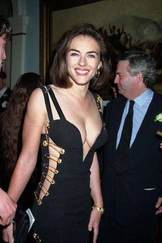 Liz Hurley in a versace safety pins black dress