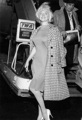 A vintage photo of Marilyn Monroe in a coat - SoLovesVintage