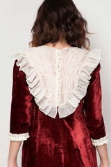 The back of SoLovesVintage velvet vintage burgundy dress