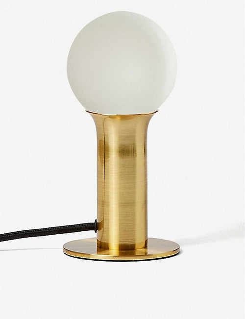 x Well-lit brass table lamp