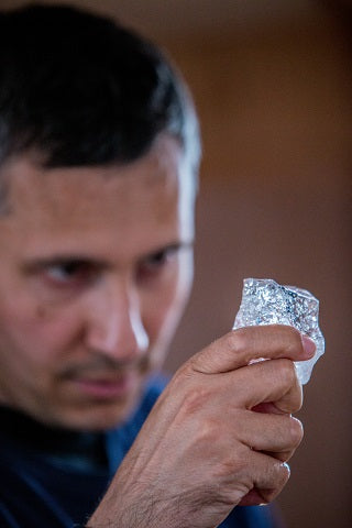 Inspecting an iceberg piece for drinking
