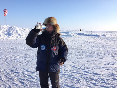 Drinking iceberg water on the sea ice at Barneo base by North Pole