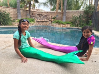 happy customers with mermaid tails