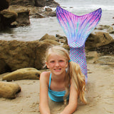 mermaid tail on the beach in Aurora Borealis