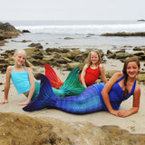 Mermaids on the beach in Sun Tail Mermaid tails and monofins