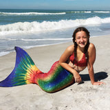 Mermaid tail rainbow on beach
