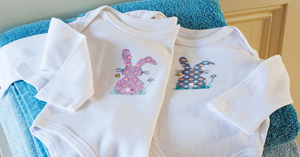 Cross-stitch bunny baby-grow