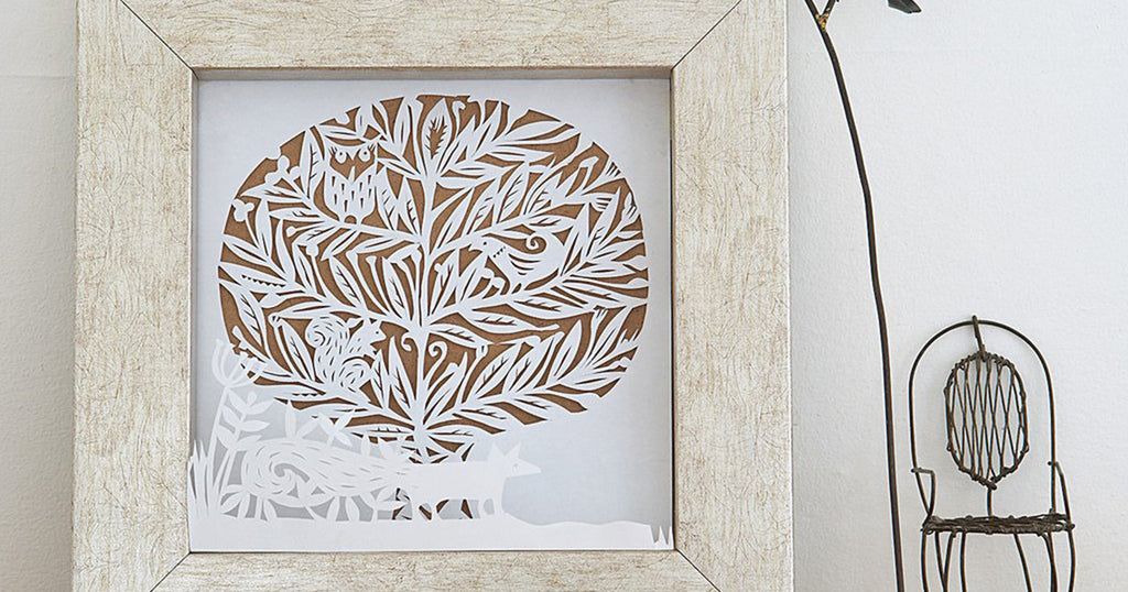 Paper-cut winter woodland scene