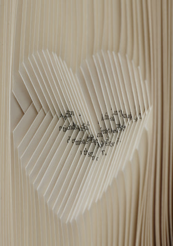 Close up of folded pages heart shape