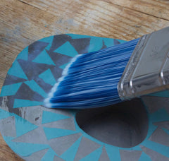 Painting a clear varnish over the pattern