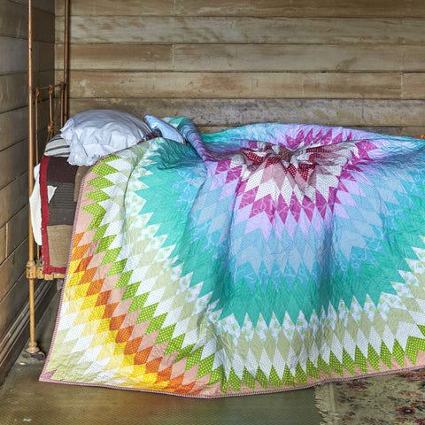 rainbow coloured embroidered quilt