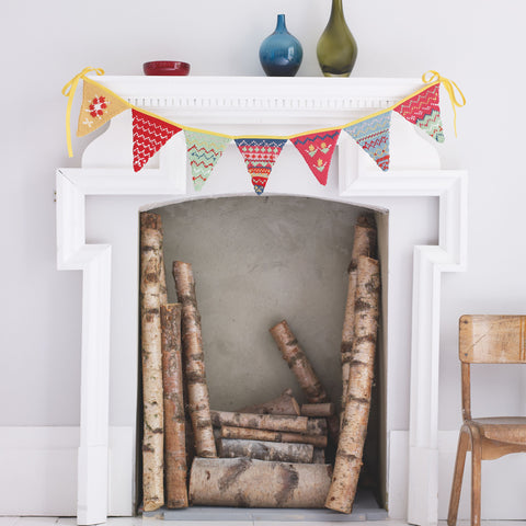 Knitted Fair Isle bunting on fireplace