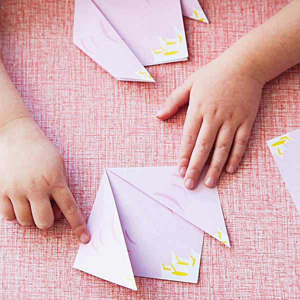 child making origami