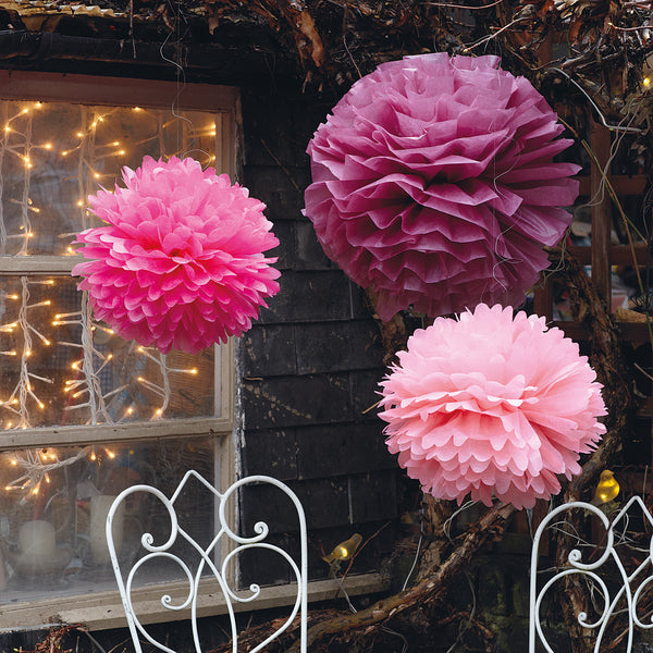 pink and purple paper pom poms