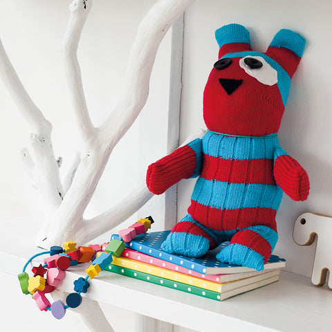 red and blue striped toy bear