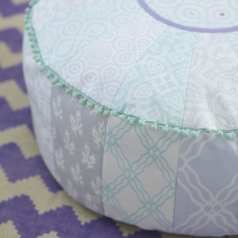 patterned sewn round cushion