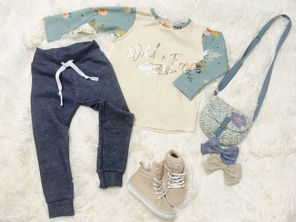 Denim Blue French Terry Joggers Flat lay with Blue Steel Floral and Cream Raglan Top, cream colored sneakers, and hair bows.