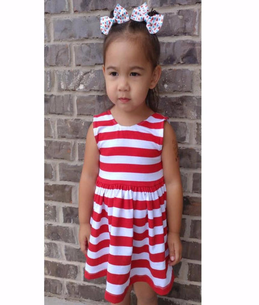 Brand Rep Girl featured wearing our Red/white striped peplum top with firecracker leather hair bows.