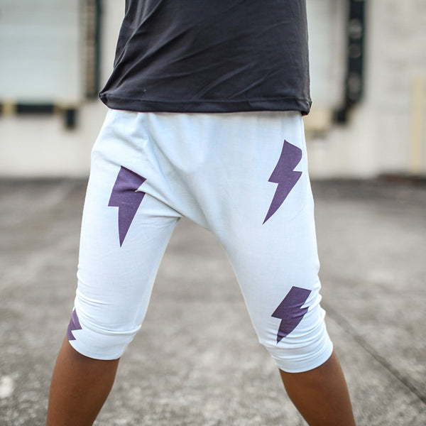 young boy wearing monochrome lightning bolt shorts for kids pure threads co
