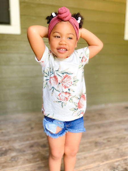 little girl wearing jean shorts and pink rose floral tee shirt handmade girls clothes from pure threads co