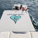 Slip and slide inflatable swim pad dock mat