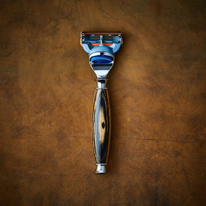 classic shaving razor in black and white ebony wood