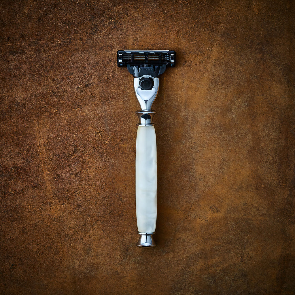 Acrylic shaving razor in white for Gillette Mach3 and Gillette Venus blades