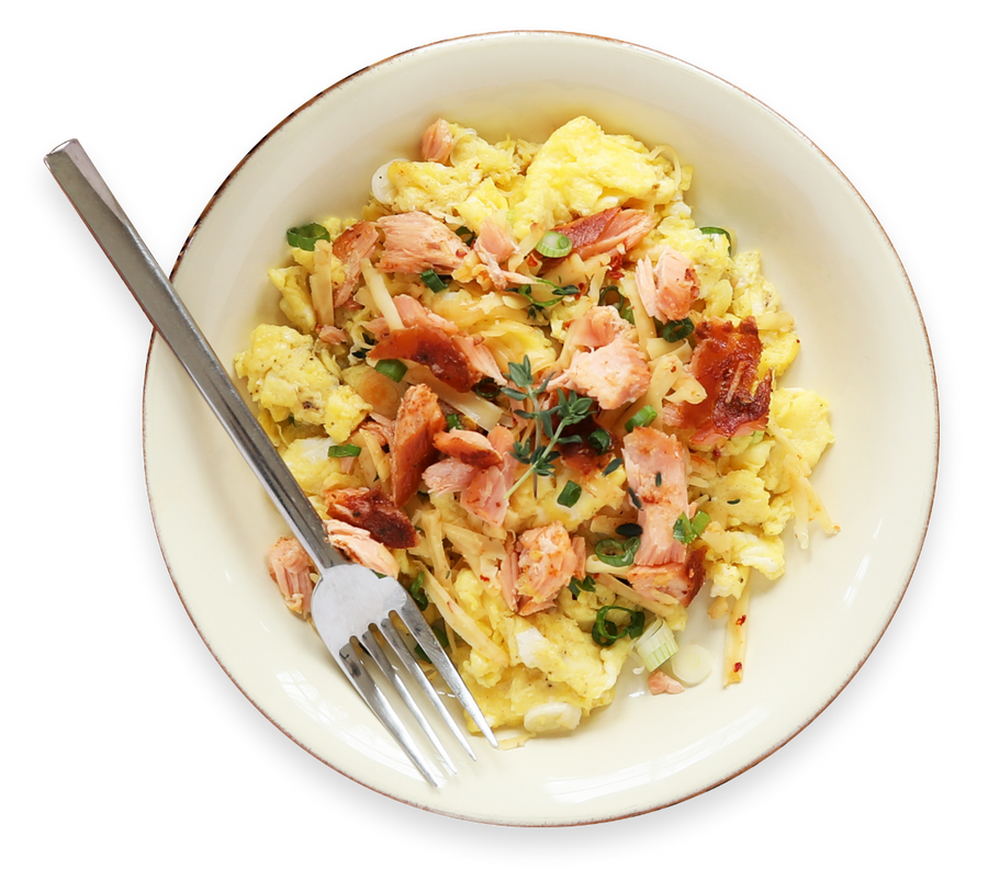 Eggs and smoked salmon in dish with fork
