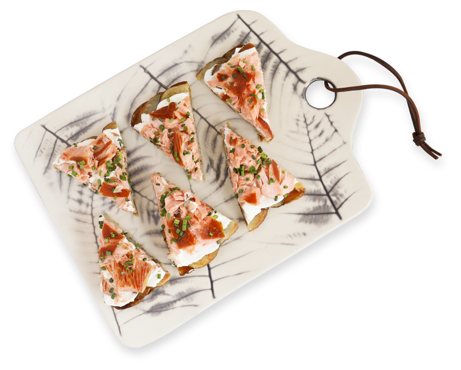 Salmon Pizza slices on a marble cutting board