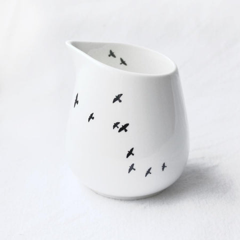White milk jug with bird print