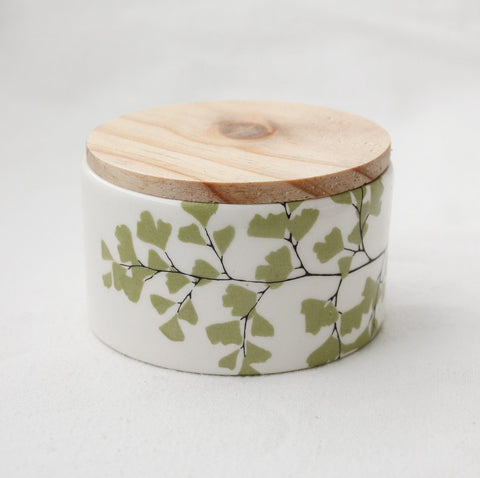 White storage jar with wooden lid