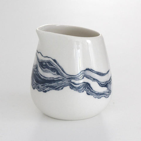 White milk jug with blue mineral print