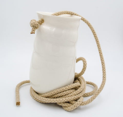 White medium ceramic vase with rope