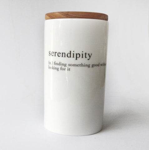 white tall jar with serendipity message