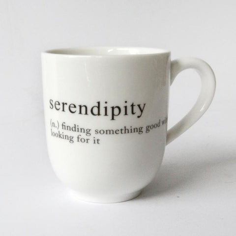 white mug with serendipity message