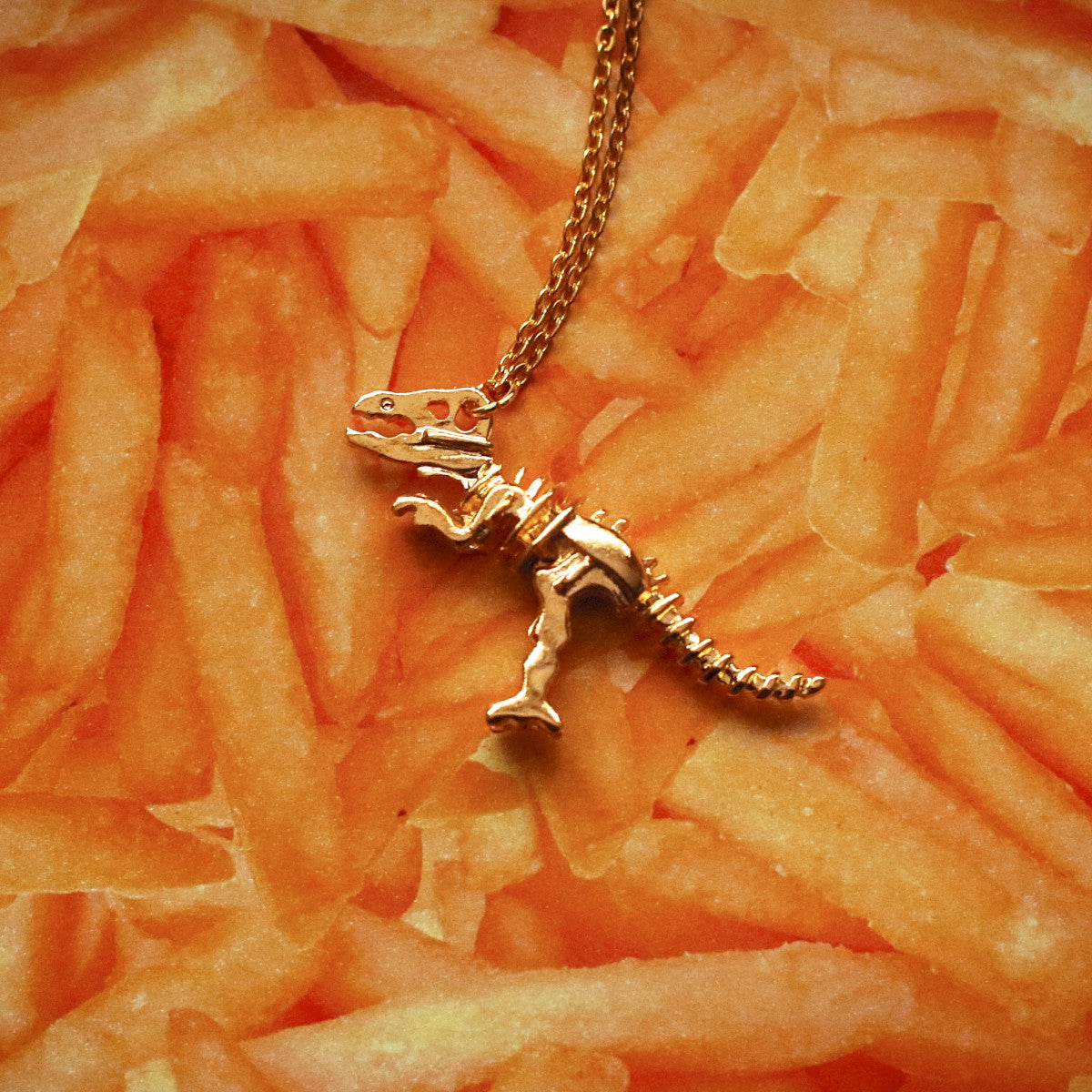 Gold T-rex dinosaur skeleton necklace - Ice Cream Cake
