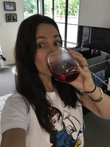Ash from Eskimo Nell drinking wine in I've Got This tee