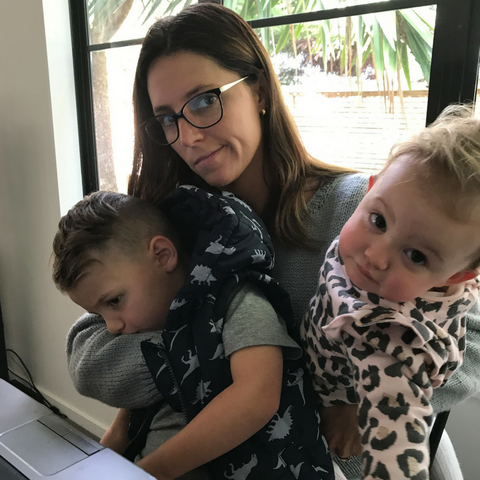 Ash trying to blog with her kids crying on her lap | Eskimo Nell