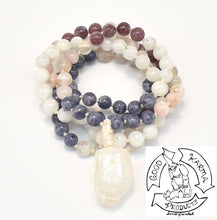 "Load image into Gallery viewer, ""Macraméd Hopeful Mirror "" - Iolite, Flower Agate, Lepidolite, Moonstone, and Macraméd  Quartz 108 Stone Mala"
