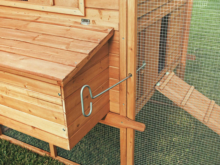 The Ranch chicken coop's pull rod makes it easy to open and close the run's access door